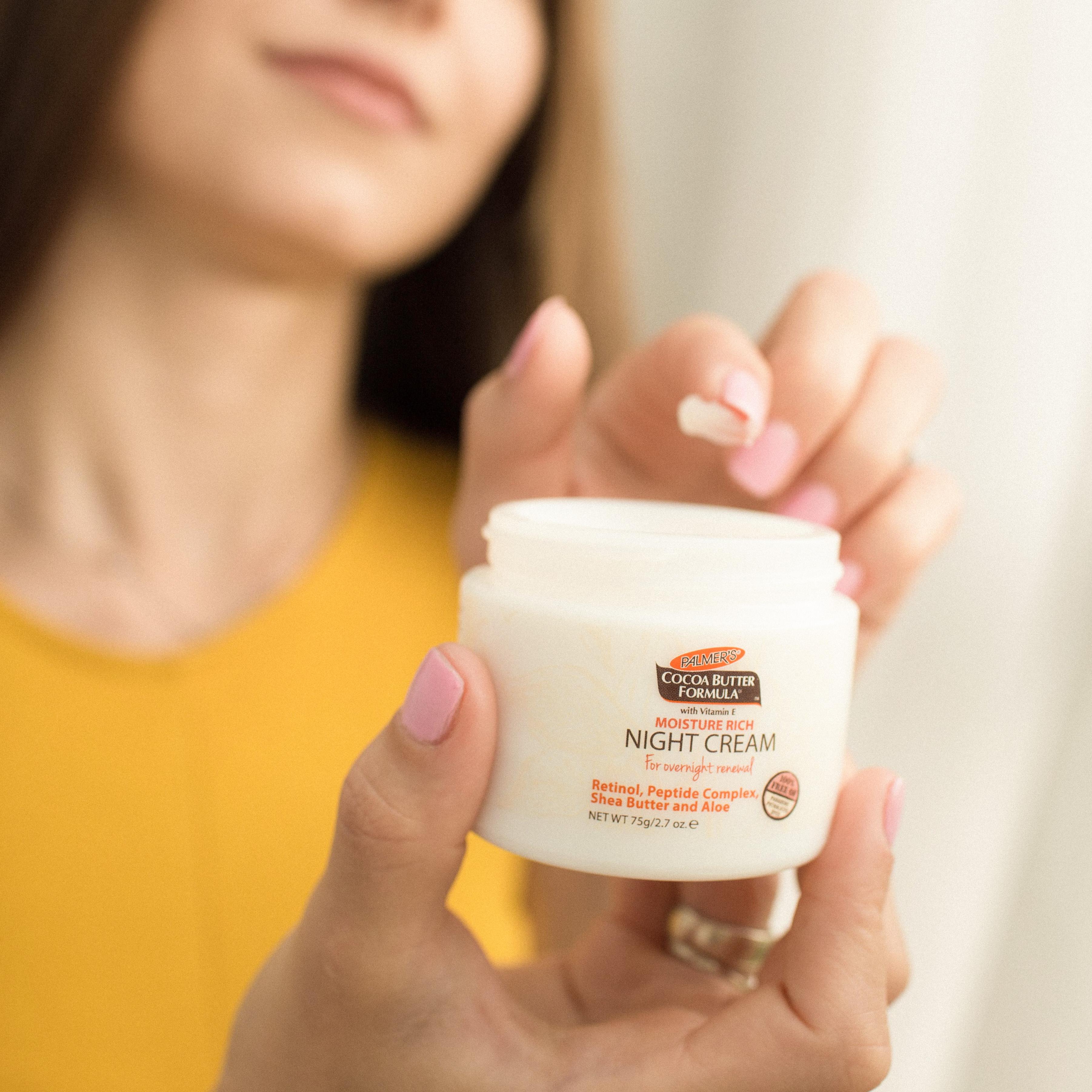 Palmer's Cocoa Butter Formula Moisture Rich Night Cream, a retinol night cream, in hand