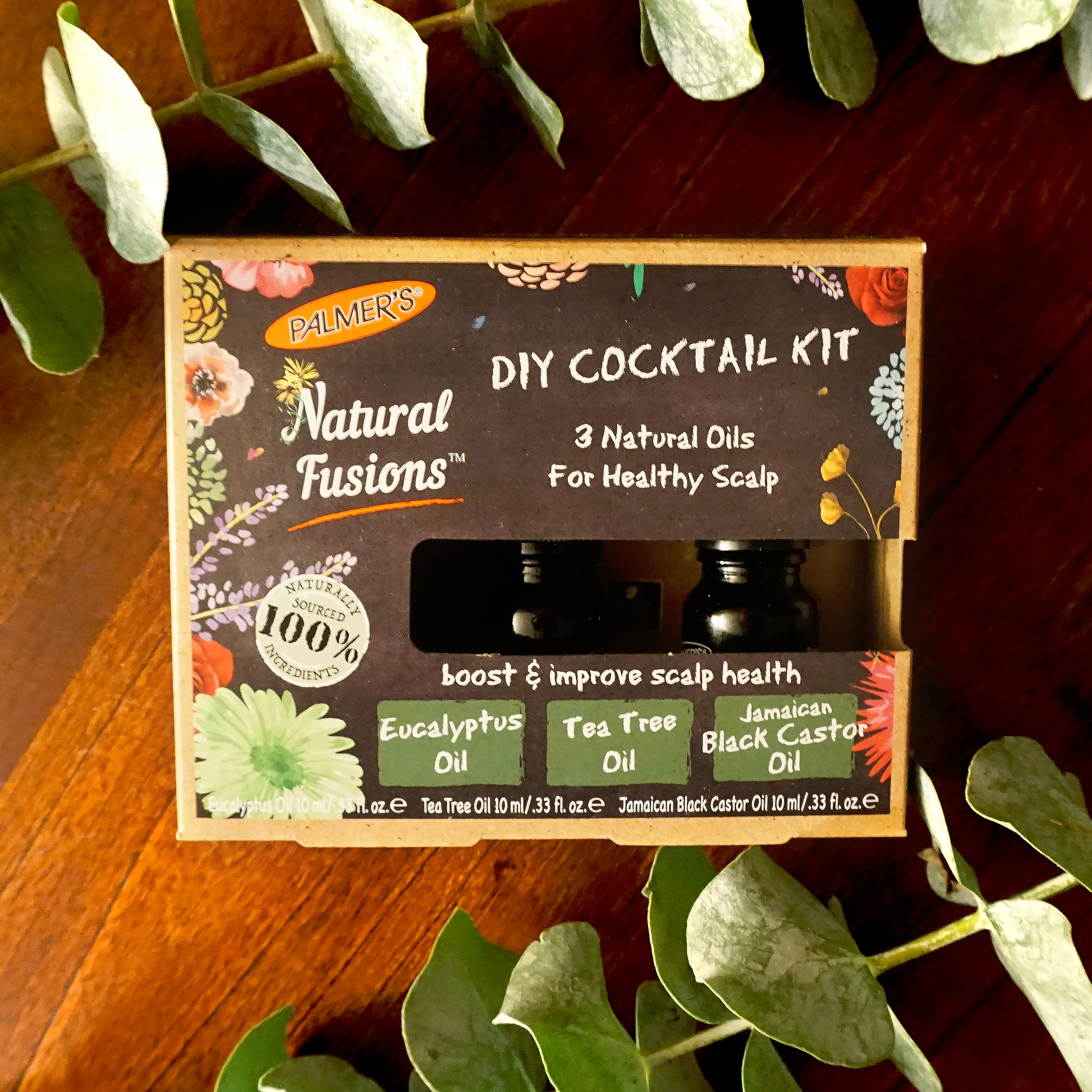 Palmer's Natural Fusions DIY Healthy Scalp Cocktail Kit on a table with flowers