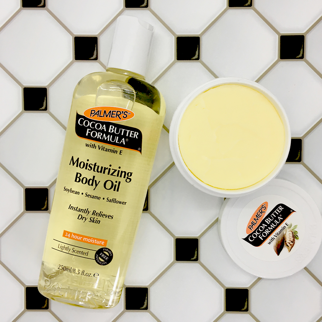 Palmer's Cocoa Butter Formula Moisturizing Body Oil and Original Solid Jar on a table