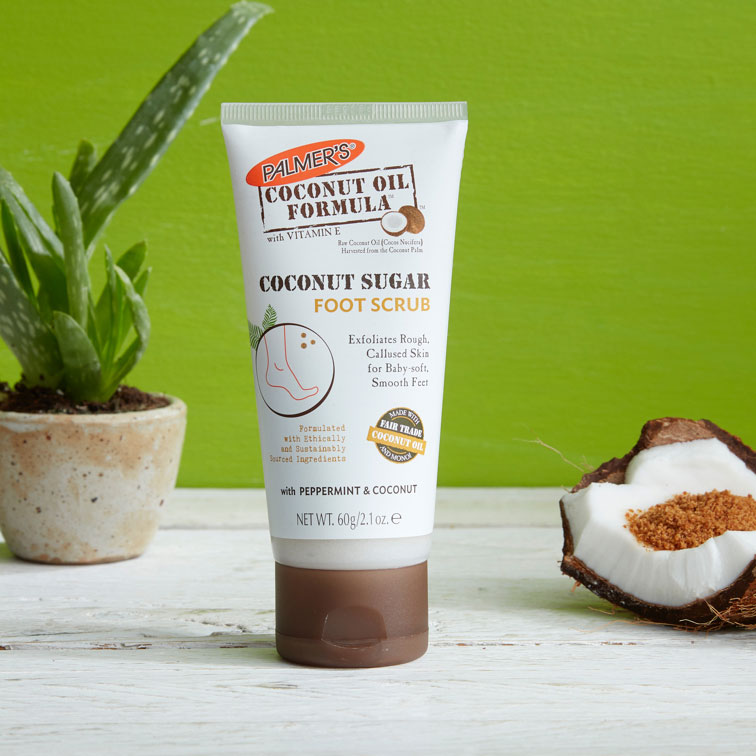 Coconut Sugar Foot Scrub, a coconut oil for feet product on a table with coconut sugar in a coconut shell