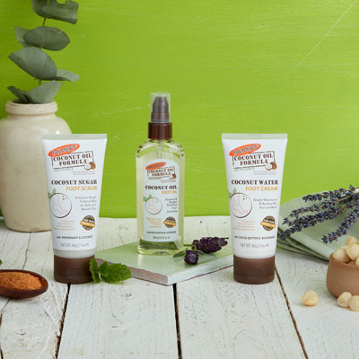 Palmer's Coconut Oil Formula Foot Care, ideal for your fall skin care routine, on a table with ingredients