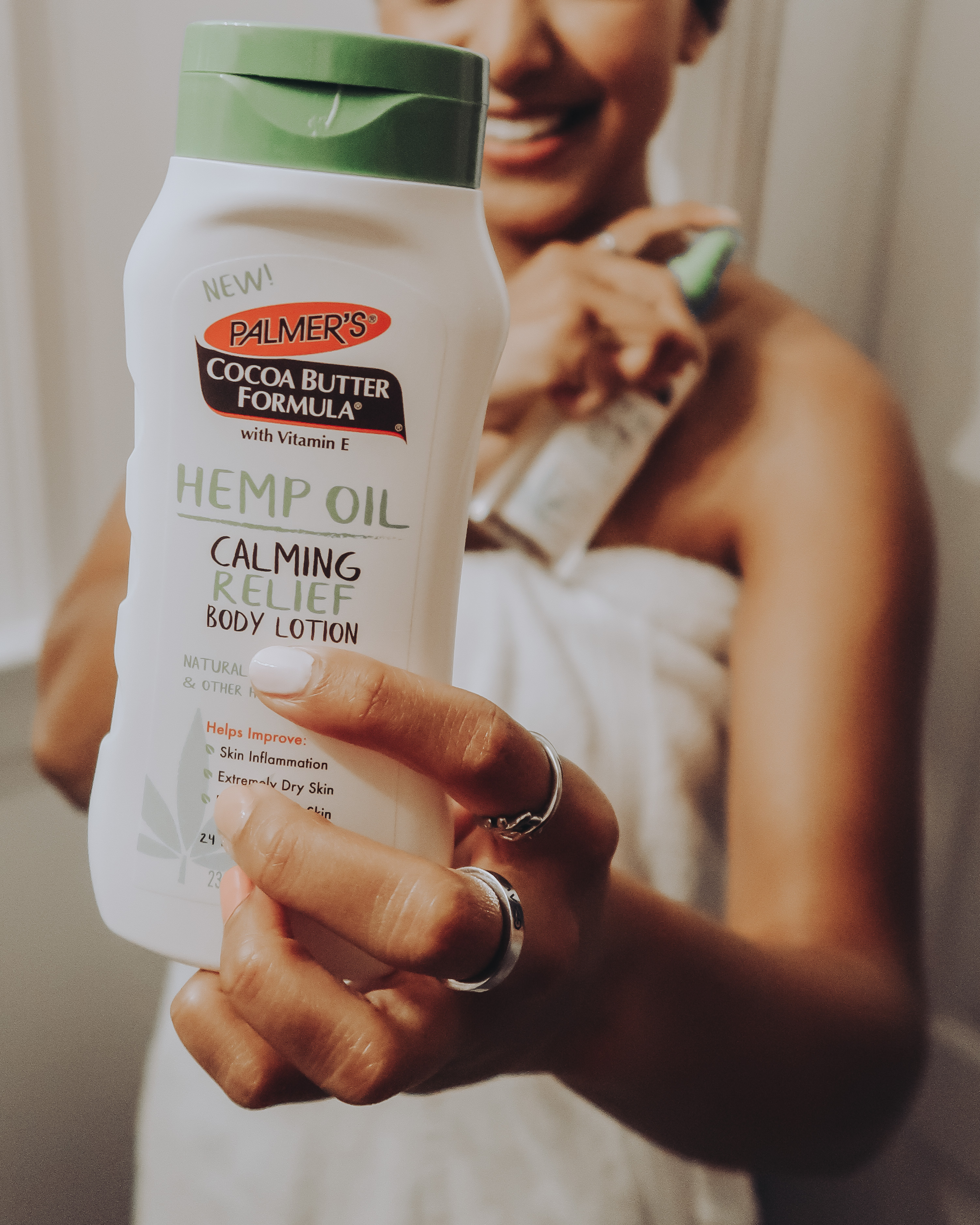 Palmer's Hemp Oil Calming Relief Body Lotion for dry, irritated skin in hand
