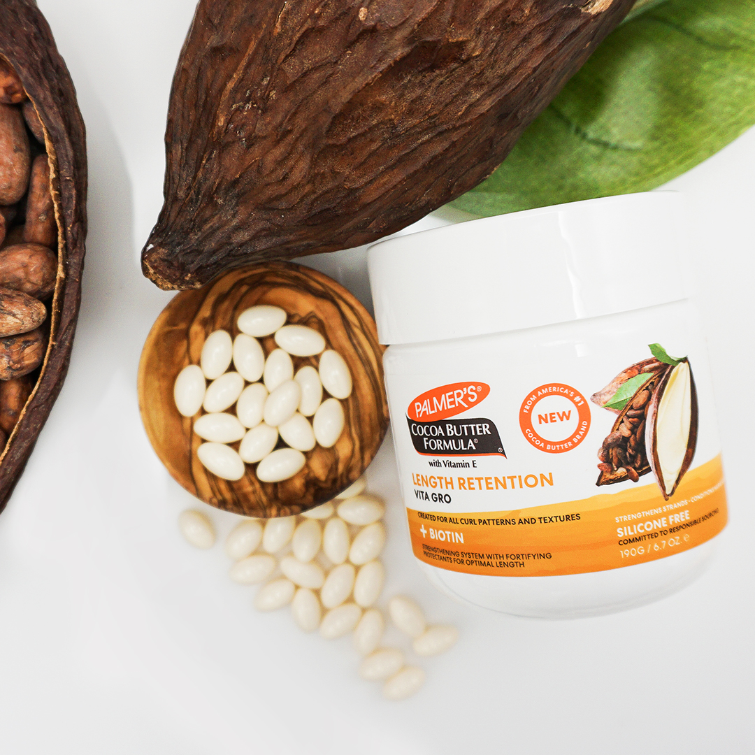Palmer's Cocoa Butter Formula Length Retention Vita Gro on table with ingredients