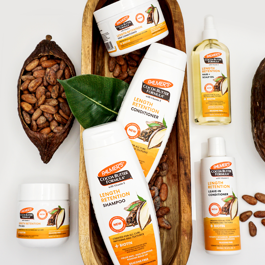 Palmer's Cocoa Butter Formula Length Retention with Biotin products for fragile or brittle hair on table with ingredients