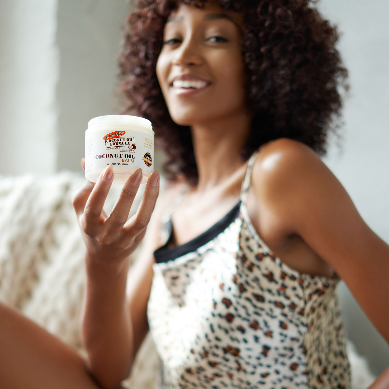 Palmer's Coconut Oil Balm being held in Black woman's hand