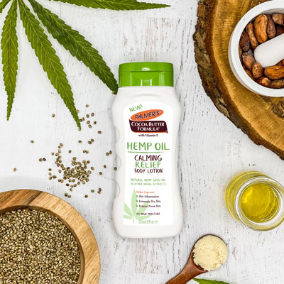 Palmer's Hemp Oil Calming Relief Body Lotion for moisturizing dry winter skin on table with ingredient