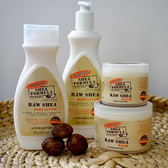 Palmer's Shea Formula Raw Shea Butter collection in a tray with shea nuts