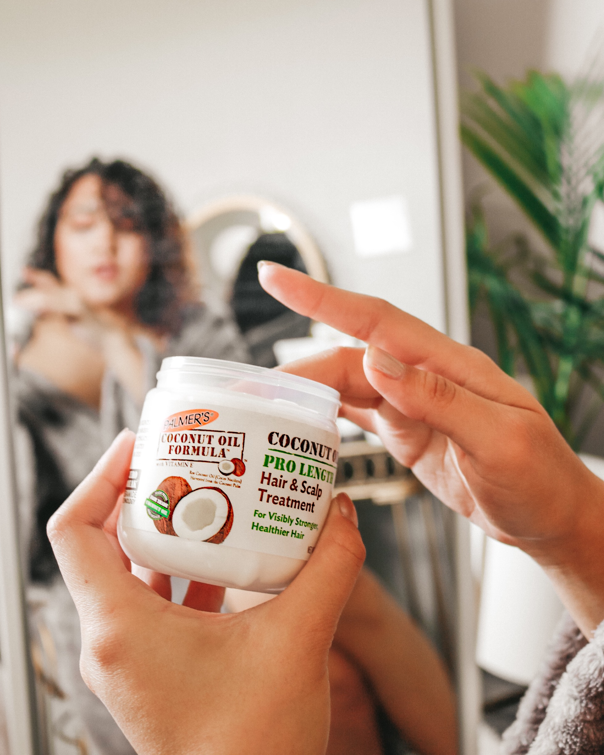 Palmer's Coconut Oil Formula Pro Length Treatment for damaged hair being applied