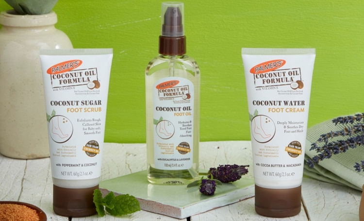 Palmer's Coconut Oil Foot Oil, Coconut Water Foot Cream and Coconut Sugar Foot Scrub on a table