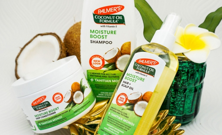 Palmer' Coconut Oil Formula Moisture Boost products for moisturizing hair in a protective style on table
