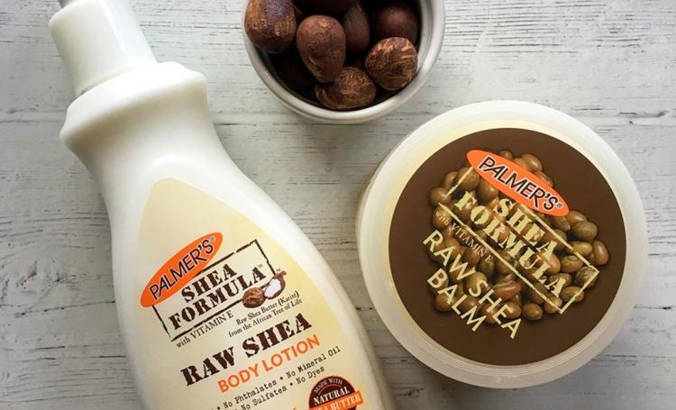 Palmer's Shea Formula Raw Shea Body Lotion and Raw Shea Balm, the best shea butter skin care, on a table